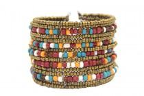 Bracelet manchette or jaune et perles bois amérindien