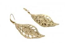 Boucles d'oreilles dorée pendantes