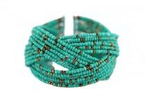 Bracelet manchette en perles turquoise ajourées